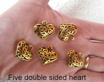 Heart Charms - Five double-sided, hollow filigree heart charms in antique gold