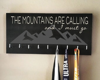 """Race Medal Holder - """"The mountains are calling and I must go"""" white and gray with black background"""