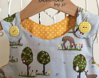 Reversible Dress, girls pinafore, forest friends Design, with yellow spot poplin, applique forest friends, 2 in 1 dress with spotty buttons
