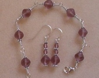 Sterling silver wire wrapped bracelet and earrings with purple Czech glass beads