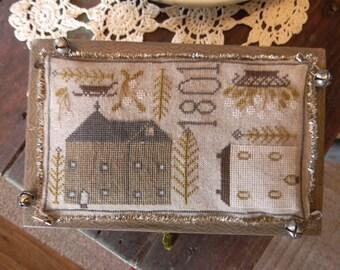 Pattern: Tinsel Towne Cross Stitch created by Notforgotten Farm