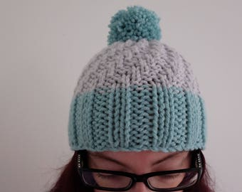 Pale/pastel blue and light grey knitted winter woolly hat with pom pom/bobble detail