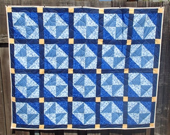 Blue and yellow lap quilt