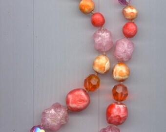 Pretty vintage Vogue necklace - beads in pinks, oranges, reddish orange