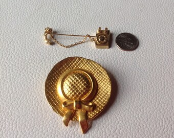 Hat brooch and telephone pin