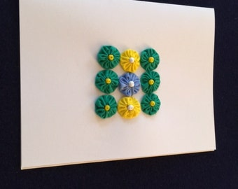 Greeting Card with Green and Blue Flower Design