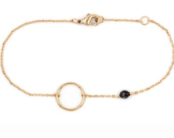 Bracelet one round and gold plated stone