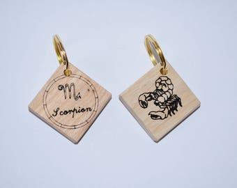 Zodiac sign Scorpio wooden keychain.