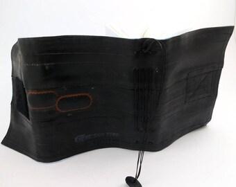 Journal, recycled bicycle inner tube, handmade blank, medium. Black velcro closure, blue felt linen .