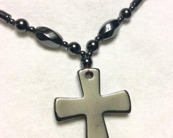 Vintage 1970's hematite tube beads cross pendant necklace .