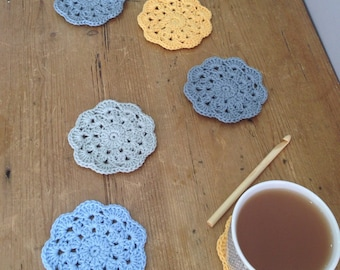 Crochet coasters. Cloudy with a chance of sunshine crochet coasters.