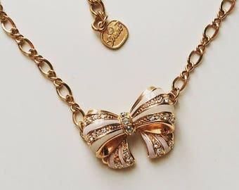Vintage signed Grossé Germany rhinestone bow pendant gold tone necklace