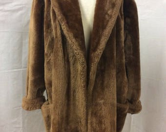 1960's honey- brown vintage faux fur coat with pockets