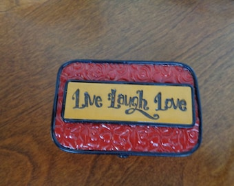 """Prayer box, """"Live Laugh Love"""" stamping in red and gold textured polymer clay"""