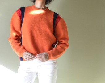 "70s/80s 100% thick wool pullover with puff sleeve, ribbed navy/red at side seams // xs- m // 40"" bust"