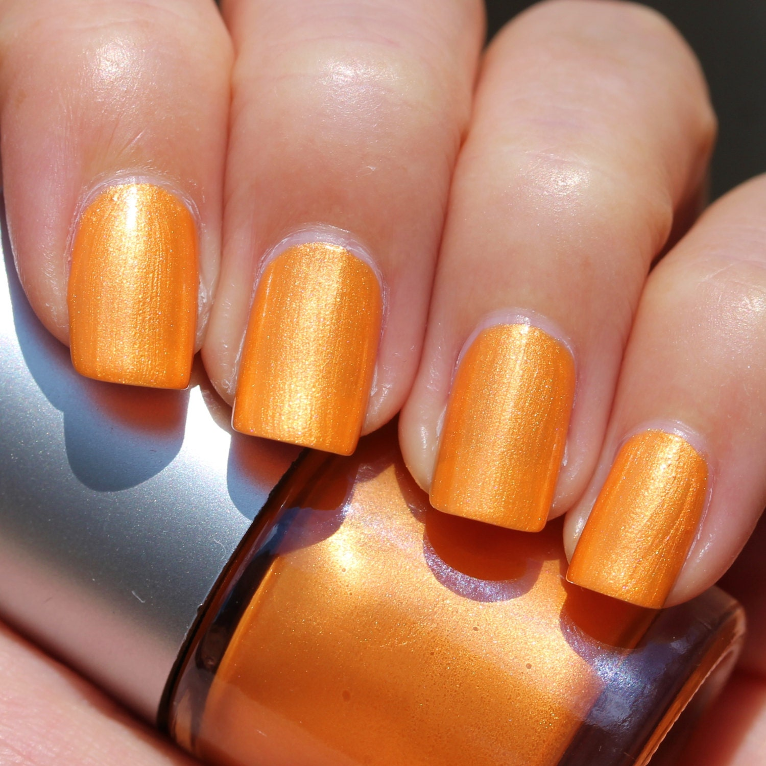 Sunet Franken Nail Polish Bright orange color with gold