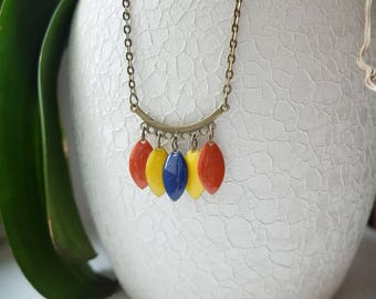 Brass necklace with enamel yellow, rust and blue night
