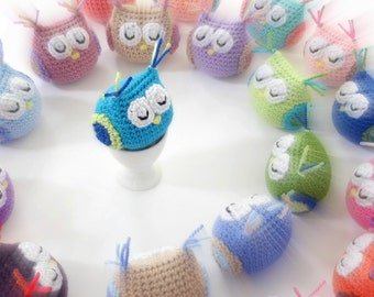 Handmade crochet animal toy. Amigurumi owls.