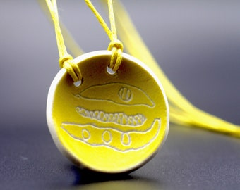 """Ceramic """"Gather & Share"""" pendant, hand painted yellow with string bean design. Yellow cotton cord necklace jewellery."""