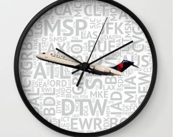 Delta Airlines 717 with Airport Codes - Wall Clock