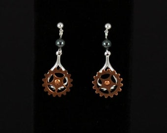 """Steampunk moving """"Gearrings"""" in silver plated brass and antiqued copper plated brass with hematite accents by Sylvan Creations."""