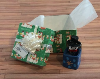 Miniature Snowman Jack in the box toy in a Green Gift Box with a white bow on top