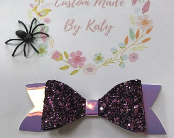 Purple glitter bow with purple patent tail