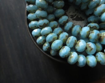 blue Czech glass beads, faceted rondelle, light  blue  opaque tone with picasso edges   6mm x 8mm / 12 beads  5CZ560