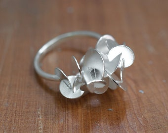 Silver reflecting discs ring