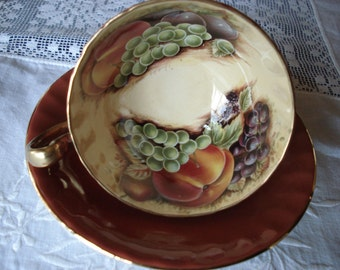 Brown or Terra Cotta Aynsley Cup and Saucer with Fruit on Interior of Cup