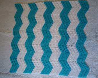 Turquoise and white baby afghan or lap blanket, hand crocheted in ripple stitch using Red Heart yarn, very soft.  Measures 34 by 35 inches.