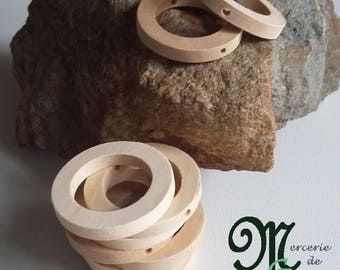 Ring natural wooden 3 cm in diameter with holes. Sold individually.