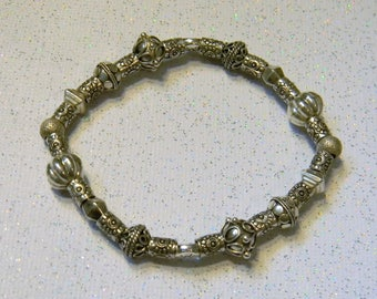 All Silver Bali Bead and Sun Stamped Hill Tribe Tube Stretch Bracelet