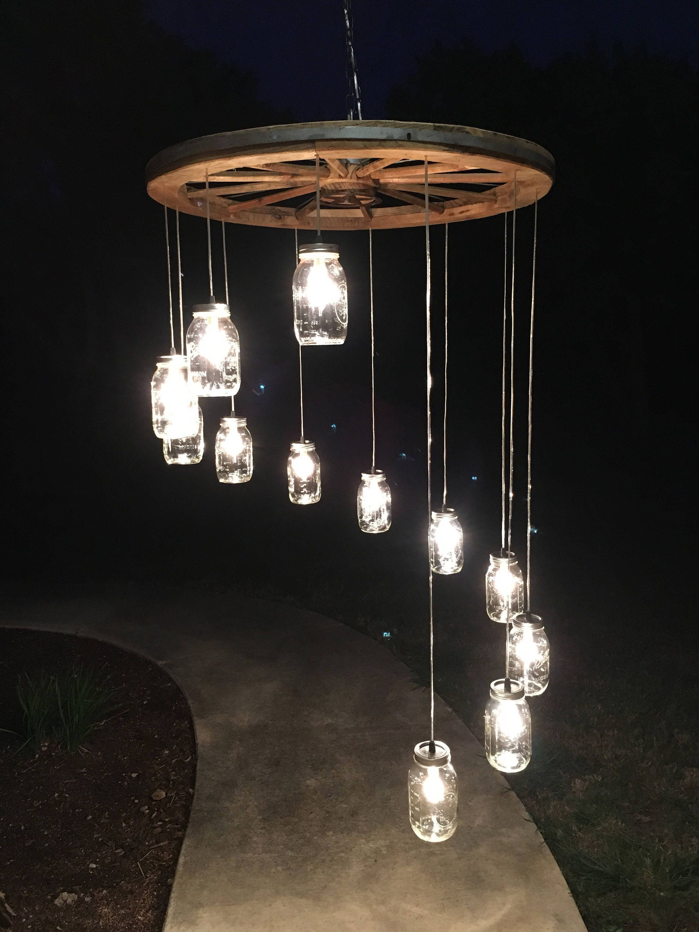 Etsy your place to buy and sell all things handmade spiral wagon wheel mason jar chandelier large arubaitofo Gallery