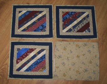 Set of 4 Machine Pieced and Quilted Mini Placemats in shades of red, blue, cream and tan