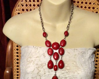 Dyed red howlite gemstone cabochons bib necklace.