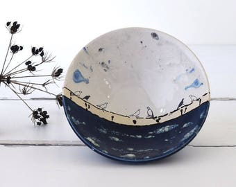 Ceramic bowl with birds on a wire under a stormy sky, illustrated ceramics, handmade pottery