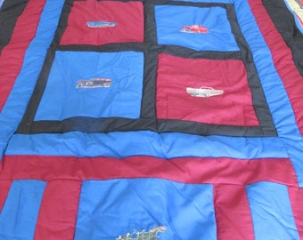 Quilt with antique cars embroidered on it
