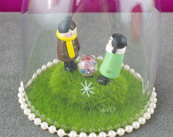 Handmade cloche, diorama. Boy and girl on mossy rock with sparkly orb.