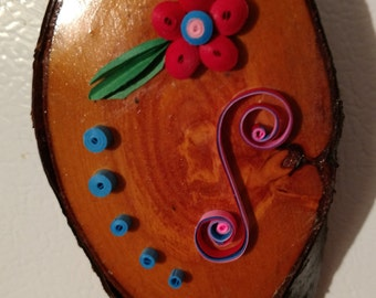 Whimsical quilled magnet