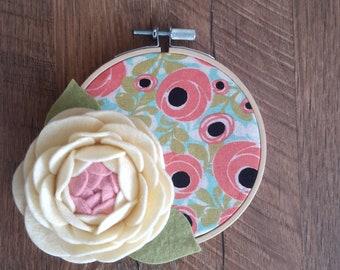 Embroidery hoop art with felt flowers