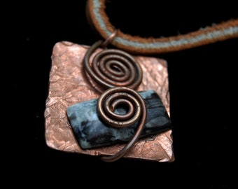 Textured copper pendent with Fraser river stone