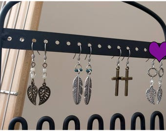 1.25-inch earrings with textured decorative antiqued silver hoop clear beads and aniqued silver leaf charm