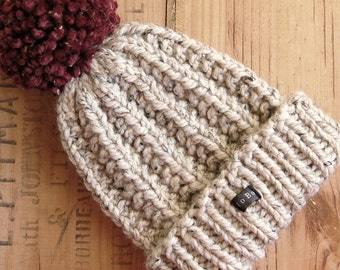 Mens handmade HoBo Lofty bobble hat. Thick chunky hand knit beanie, large removable dark red pom pom. Neutral beige tweed wool blend. M or L