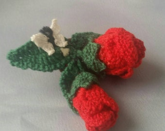 Crochet roses corsage with small butterfly