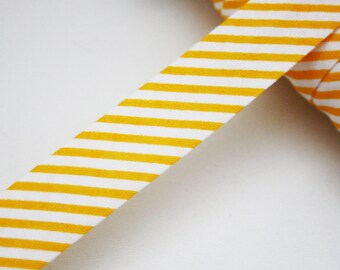 Bias striped yellow/orange and white 18 mm, folded, striped