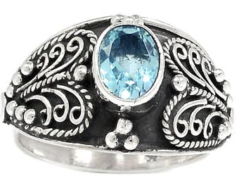 Beautiful Blue Topaz and Sterling Silver Ring size 9