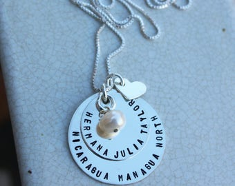 Missionary necklace, layered with a heart and charm