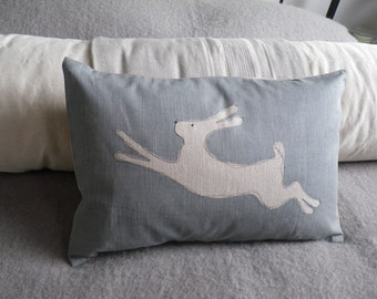 hand printed leaping linen leaping hare cushion cover