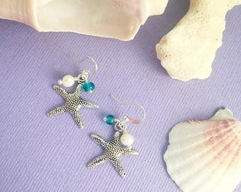 Silver starfish cluster earrings with blue glass bead and freshwater pearl